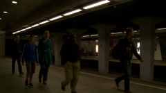 Modern metro station at platform, people in transit and commuting to work Stock Footage