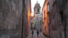 Tourists on the cobbled streets of the medieval Erice city. Sicily Stock Footage
