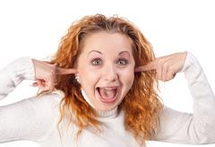 girl closes her ears by hands - stock photo