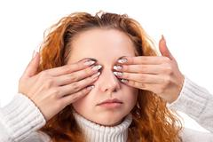 woman covering her eyes by the hands, - stock photo