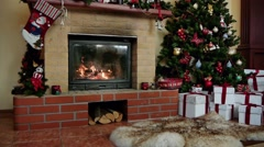 Christmas decorated house interior with fireplace - stock footage