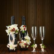 Champagne bottles with glass and wedding decoration of flower arrangements. Stock Photos