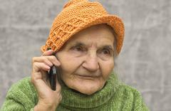 Stock Photo of portrait of a senior woman on the phone