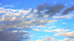 Plenty of beautiful clouds moving on blue sky Stock Footage