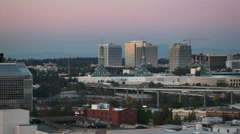 Panning Movie of City Downtown Portland OR at Sunset with Freeway Traffic 1080p Stock Footage