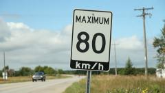 Maximum 80 km/hr sign with cars. Stock Footage