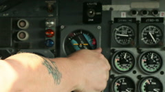 Man with tattoo operating engine controls in aircraft 01 Stock Footage