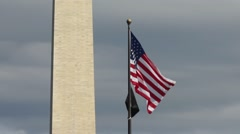 American Flag waving with Washington monument background Stock Footage
