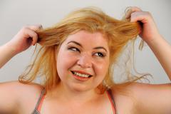 Overwhelmed hair pulling Stock Photos