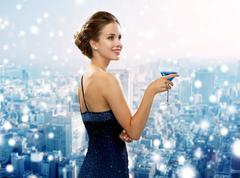Smiling woman in evening dress holding cocktail Stock Photos