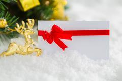 christmas decoration and gift card with snow - stock photo