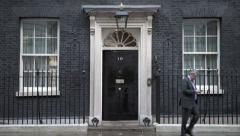 A Businessman exits 10 Downing Street in London Stock Footage