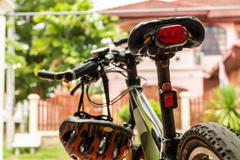 red bicycle rear lamp with mountain bike. - stock photo