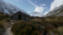 Slider shot mt cook and stocking stream shelter Stock Footage