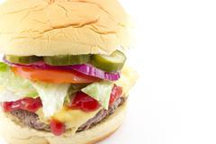 Cheeseburger lettuce tomato onion pickle Stock Photos