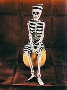 Prisoner Skeleton Sitting on Pumpkin Stock Photos