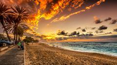 people enjoying the sunset - stock photo