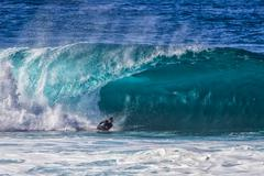 Bodyboarder at pipeline Stock Photos