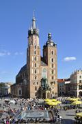 St mary church and people on main market square in krakow Stock Photos