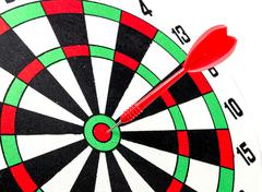 dart target with red arrows  close up - stock photo