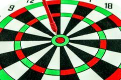 Dart target with red arrows  close up Stock Photos