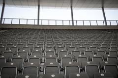 some rows of gray stadium seats, shoot from the front - stock photo