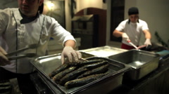 Chef puts on a tray of fried fish in Turkish fish restaurant. Stock Footage