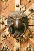 medieval door knocker in eagle contour - stock photo