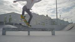SLOW MOTION: Skateboarder performing tricks in skatepark Stock Footage