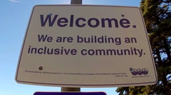 Sign- Welcome We Are Building An Inclusive Community Stock Footage