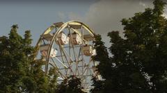 Wide shot of Ferris Wheel beyond trees at amusement park / Salt Lake City, Utah, Stock Footage