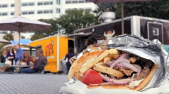 Time lapse of people ordering eating from food truck trucks pita sandwich table Stock Footage
