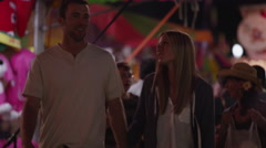 Close up of young couple walking and smiling at amusement park / Salt Lake City, Stock Footage