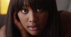 Sultry black woman looking at camera - stock footage
