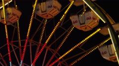 Low angle medium shot of Ferris Wheel at amusement park at night / Salt Lake Stock Footage