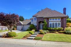 Luxury house with brick wall trim and beautiful curb appeal Stock Photos