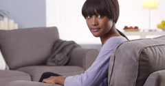 Cute black woman with bangs looking at camera Stock Footage