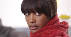 Sultry black woman wearing red blanket Stock Footage