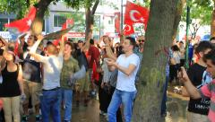 On Saturday afternoon protesters in Istanbul's Gezi Park - stock footage