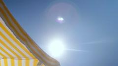 Umbrella for sun lounger blue sky and sun Stock Footage