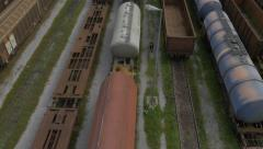 AERIAL: Old freight trains on a railroad station - stock footage