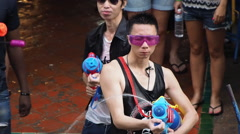 Crowd Celebrating Songkran on Khao San Road in Bangkok, Thailand Arkistovideo