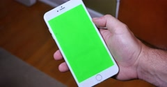4K Holding Green Screen iPhone Portrait Mode Stock Footage