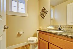 Restroom with maple vanity cabinet Stock Photos