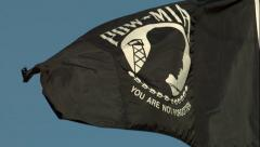 POW - MIA Flag Waving in the Wind in Slow Motion Stock Footage