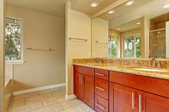 bathroom cabinet with two sinks and granite top - stock photo
