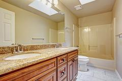 Bathroom cabinet with two sinks and granite top Stock Photos