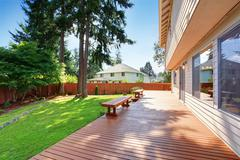 spacious wooden walkout deck - stock photo