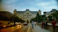 Time lapse view of Gresham Palace Budapest with traffic cars Stock Footage