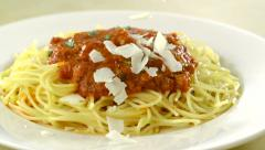 Putting parmesan chese on spaghetti, Slow Motion - stock footage